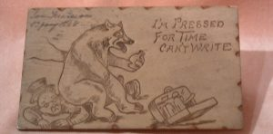 wooden postcard with pencil cartoon of a bear sitting on a gentleman
