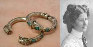 two white metal anklets with green stones and a black and white portrait of a woman